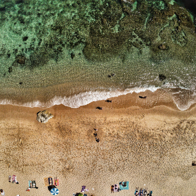 """""""AERIAL VIEW OF BEACH WATER AND PEOPLE ON THE SAND"""" stock image"""
