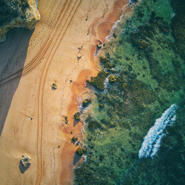"""""""Aerial view of beach water and sand morning light"""" stock image"""
