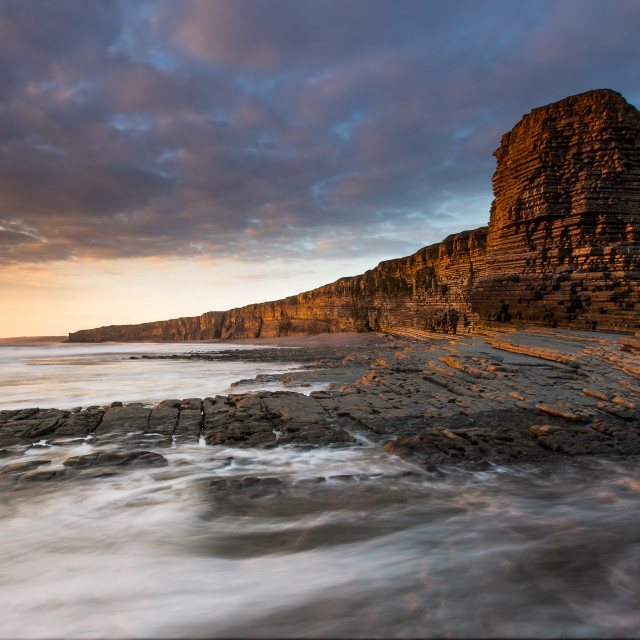 """Nash Point cliffs, sunset"" stock image"