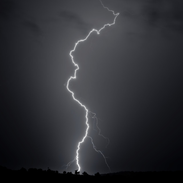 """Single lightning bolt striking the ground"" stock image"