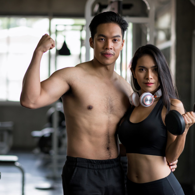 """""""Healthy Asian couple in fitness gym"""" stock image"""