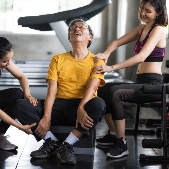 """""""Old man get massage by women at fitness gym"""" stock image"""