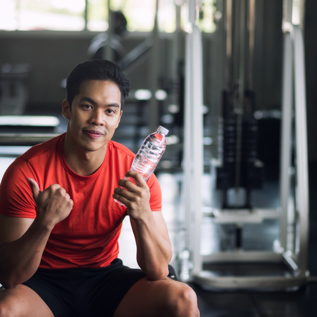 """""""muscular man hold water to drink in gym"""" stock image"""