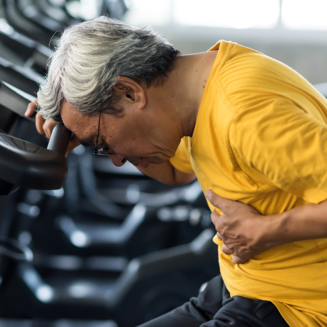 """""""Old man heart attack in fitness gym"""" stock image"""