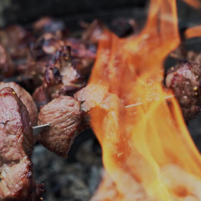 """""""Cooking shish kebab or shashlik on skewers"""" stock image"""