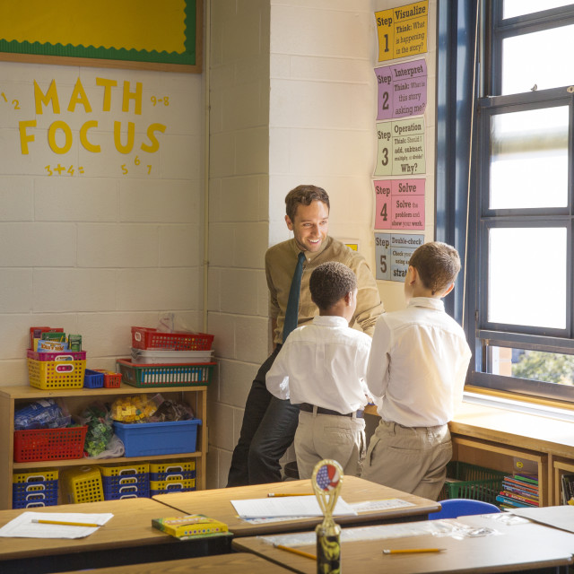"""""""Teacher Helping Students with Math After Class"""" stock image"""