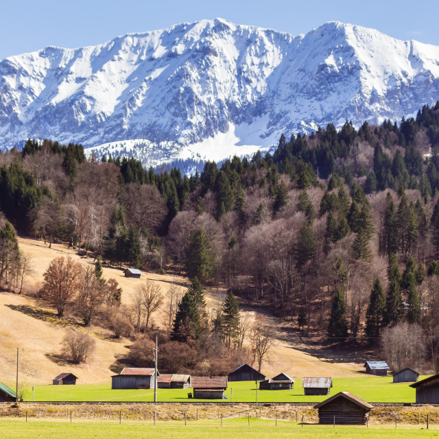 """""""Farm houses with magnificent mountains in background"""" stock image"""