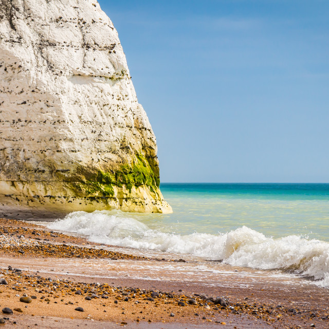"""""""waves crushing on a beach with white chalk cliffs in the background, south coast of the UK"""" stock image"""