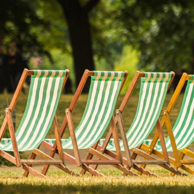 """""""London, UK - July 8th, 2018 - deckchairs stand in a row on the grass"""" stock image"""