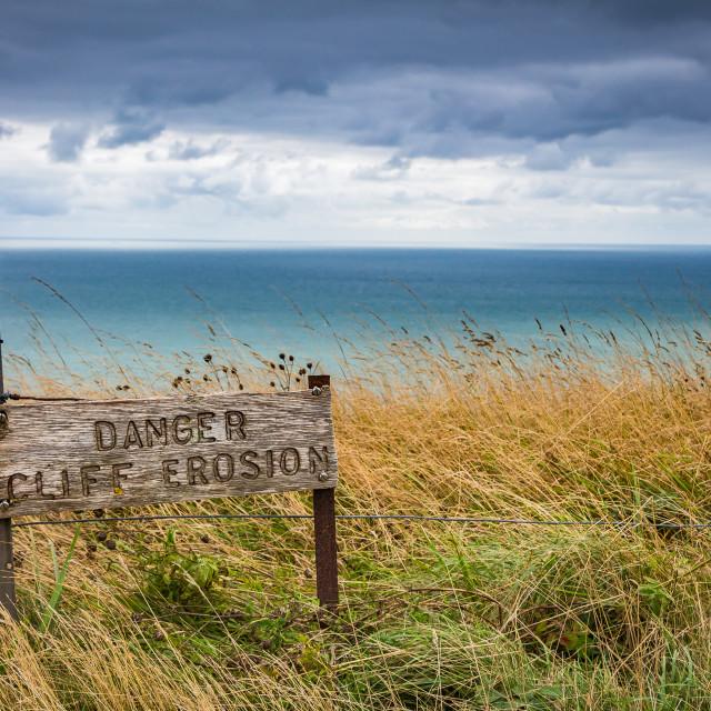 """""""Cliff erosion danger sign on the UK coast"""" stock image"""
