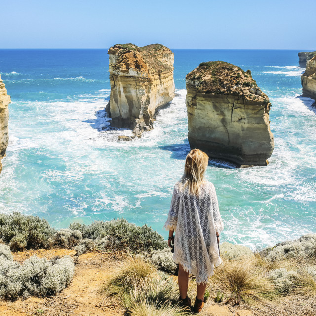 """High angle view of woman looking at view at Loch Ard Gorge against clear sky"" stock image"