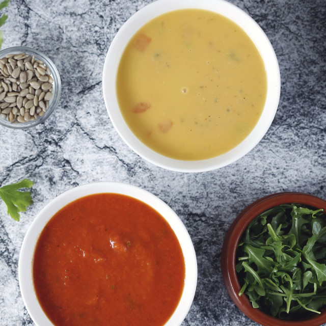 """""""Overhead view of vegetable soup served in bowls on table"""" stock image"""