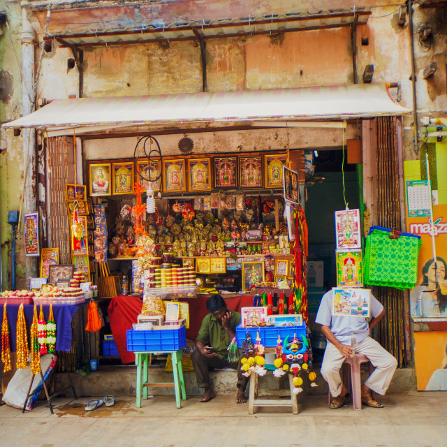 """Shopkeeper outside the temple"" stock image"