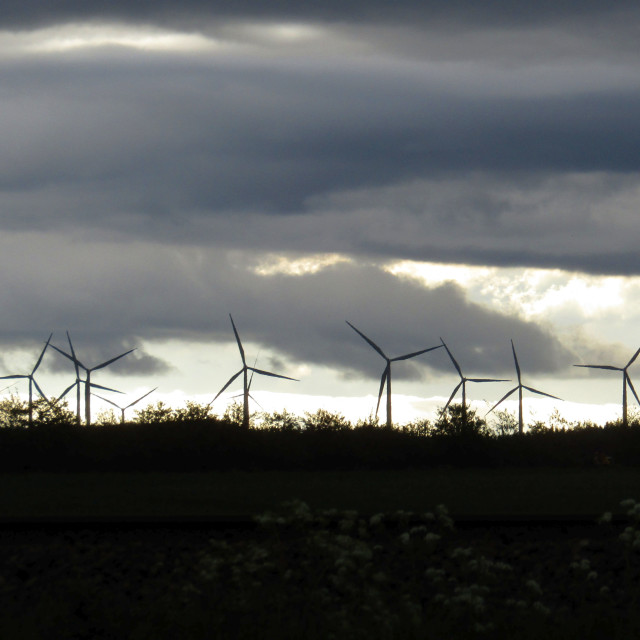 """Wind turbines in a cloudy sky, Naerbo, Norway"" stock image"