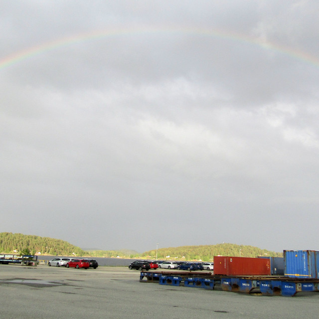 """Rainbow over Brevik, Norway dockside"" stock image"