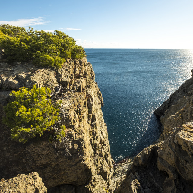 """""""Scenic view of rock formations against sea and sky"""" stock image"""