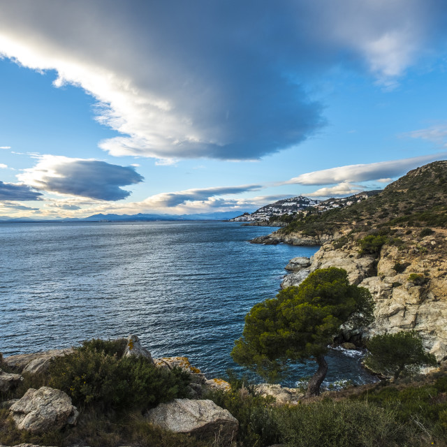 """""""Idyllic view of mountains by sea against cloudy sky"""" stock image"""