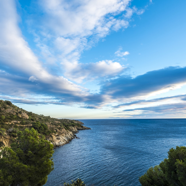 """""""Tranquil view of mountains by sea against cloudy sky"""" stock image"""