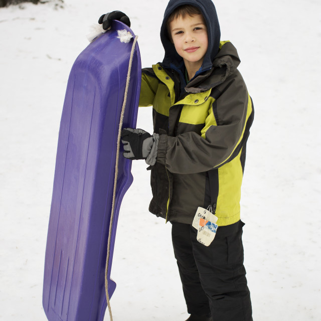 """Boy with sledge"" stock image"
