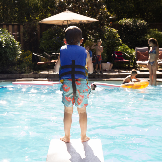 """""""Boy standing on diving board"""" stock image"""