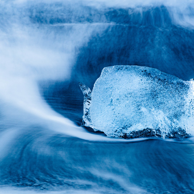 """Waves Surrounding Glacier Ice in Iceland"" stock image"