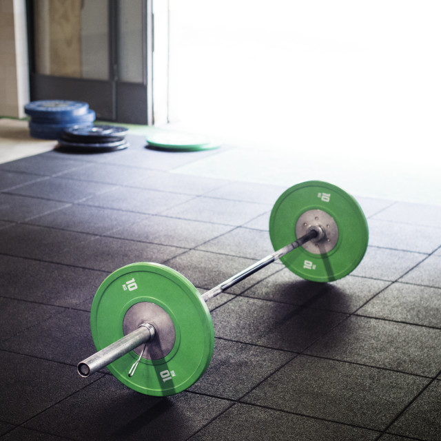 """""""High angle view of barbell in gym"""" stock image"""