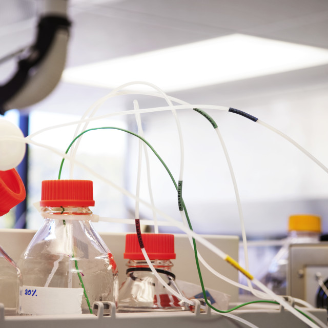 """""""Sample bottles and machinery in laboratory"""" stock image"""