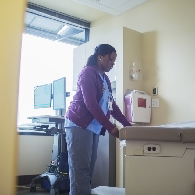 """""""Female doctor working in medical room"""" stock image"""
