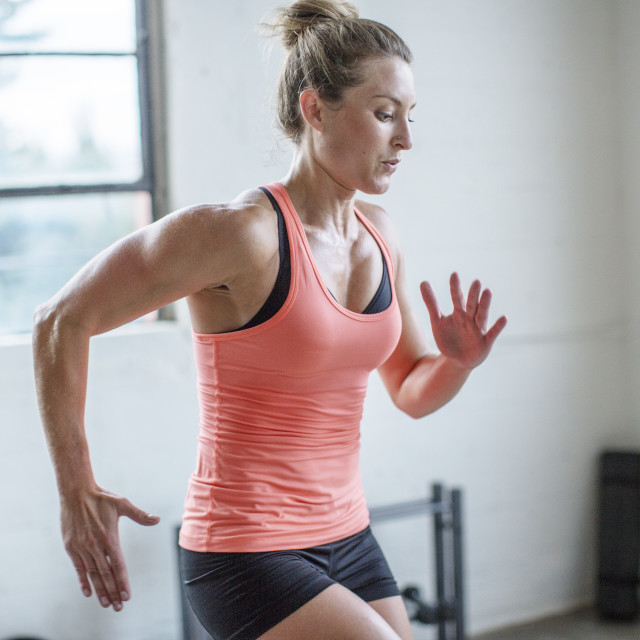 """""""Female athlete jumping in health club"""" stock image"""
