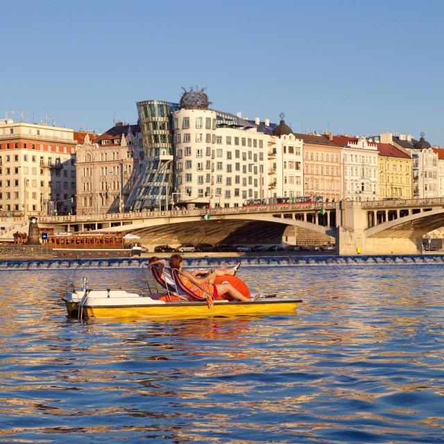 """Czech Republic, Prague - Dancing House and Pedal Boats on Vltav"" stock image"