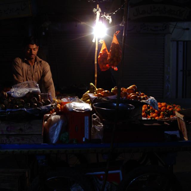 """Mid Night Fruit Seller"" stock image"