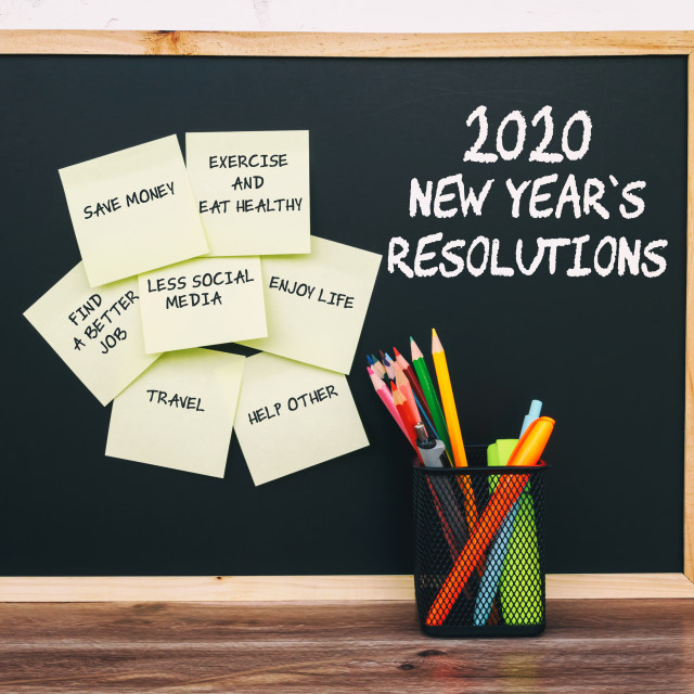 """2020 New Year Resolutions list on sticky notes with stationery"" stock image"
