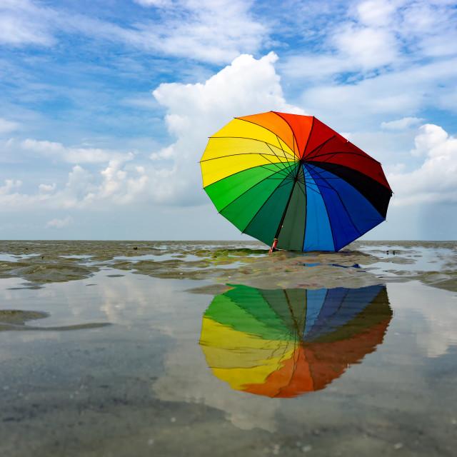 """""""Colorful umbrella and reflection at Sasaran beach in Kuala Selangor, Malaysia."""" stock image"""