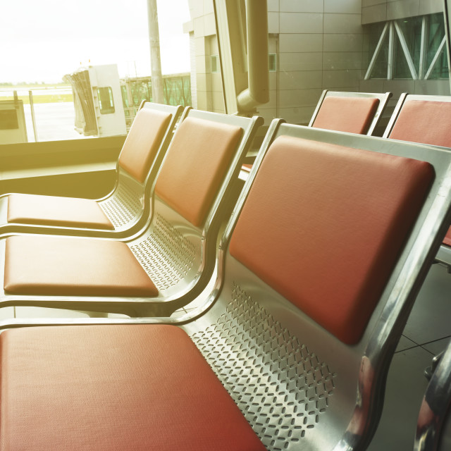 """""""Empty seat at the airport departure hall"""" stock image"""