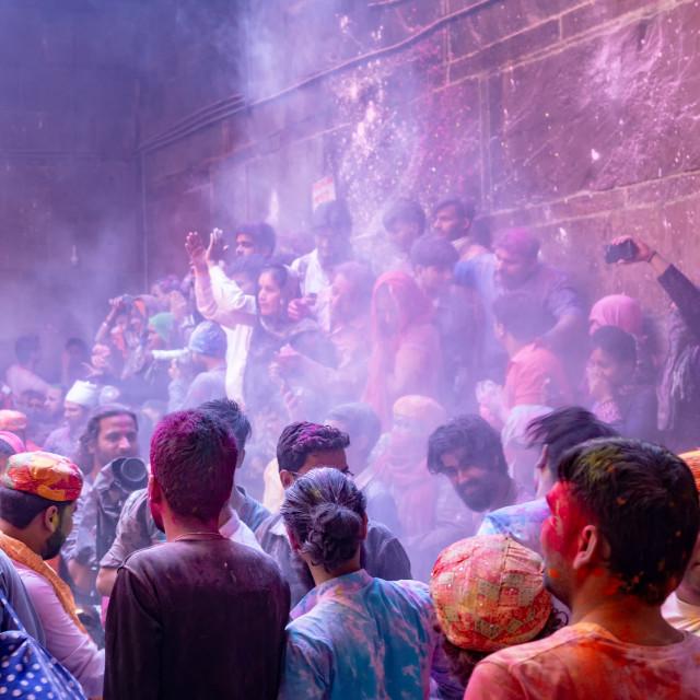 """Crowd of people inside of Banke Bhari temple in Vridavan during Holi festival celebration in Agra."" stock image"