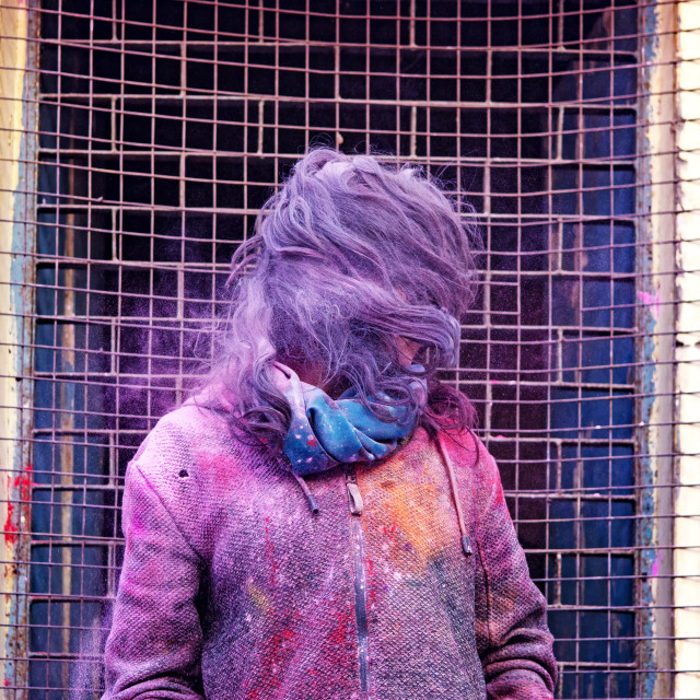 """""""Unidentified woman full with coloful pwder during Holi festival in Uttar Pradesh in Agra, India."""" stock image"""