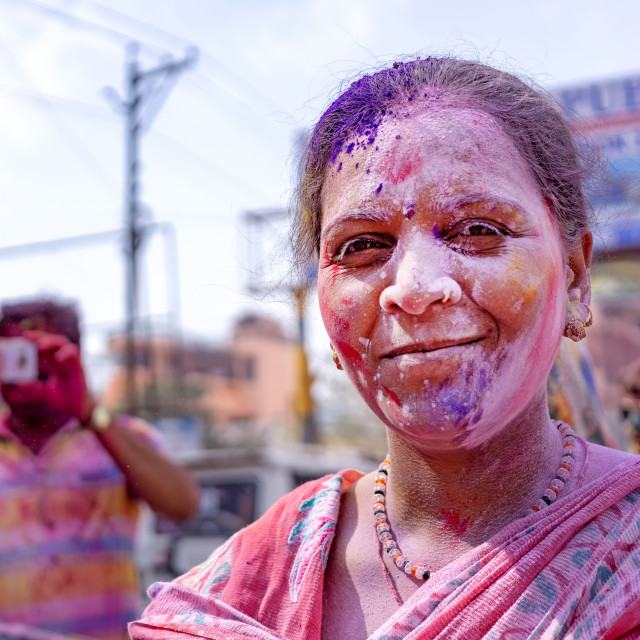 """""""Woman full of colorful powder during Holi festival celebration in Agra. Holi is a Hindu spring festival and celebrated predominantly in India."""" stock image"""