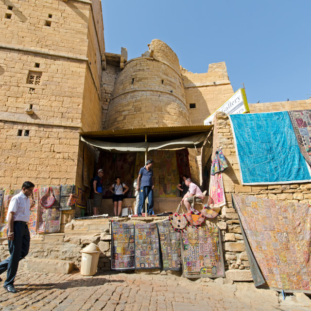 """""""Man walking on the street at Jaisalmer fort, one of the last living fort in the world."""" stock image"""