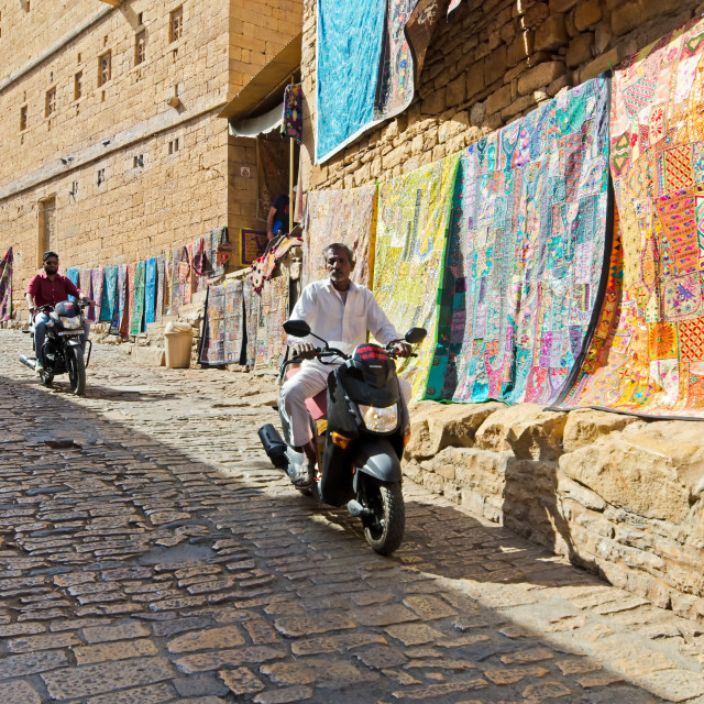 """""""Men on a motorbike at Jaisalmer fort, one of the last living fort in the world."""" stock image"""