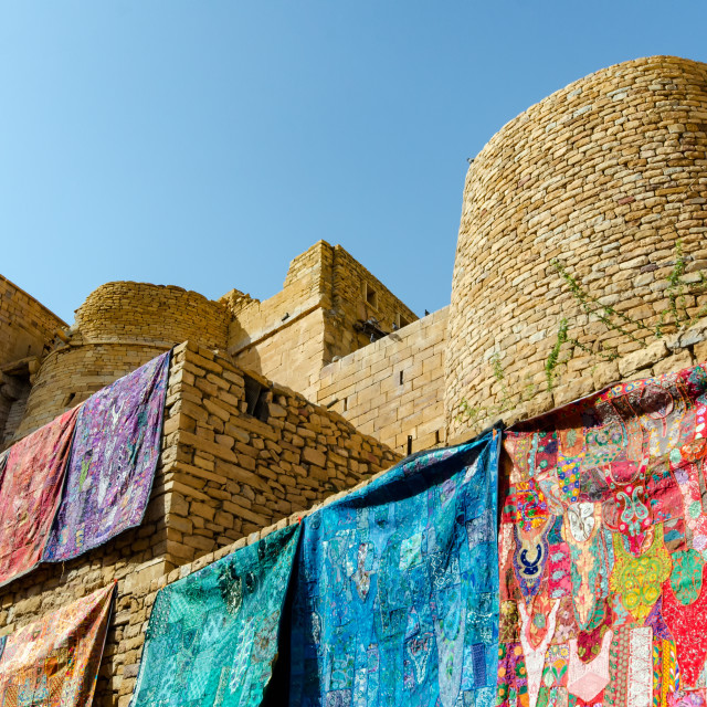 """""""Wall draped with colorful textiles inside the Jaisalmer fort in Rajasthan, India."""" stock image"""