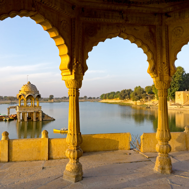 """View of Gadi Sadar temple at Gadisar lake in Jaisalmer, Rajasthan, India."" stock image"
