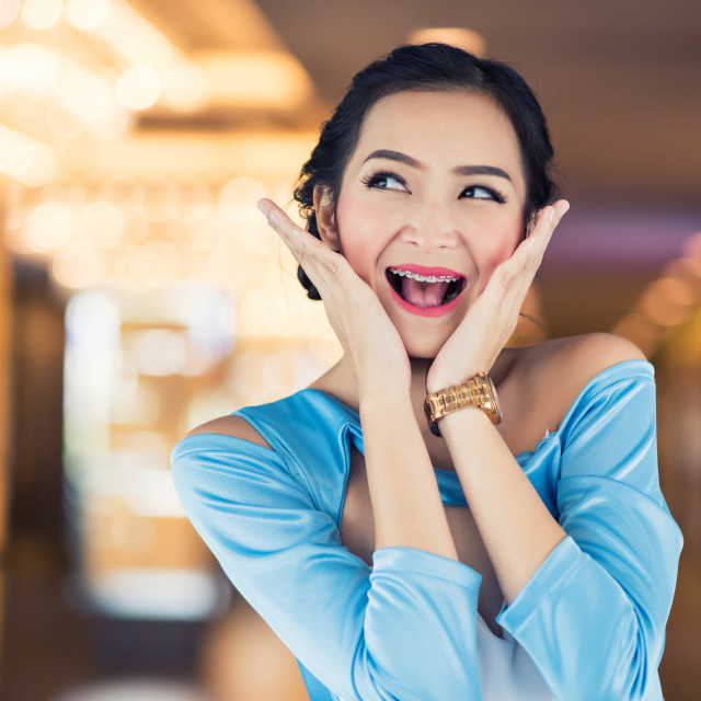 """""""wow face of excited woman at discount store."""" stock image"""