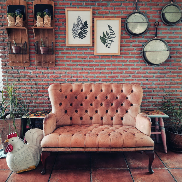 """""""armchair at brick wall of coffee cafe"""" stock image"""