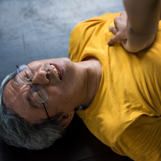 """""""CPR to old man at gym"""" stock image"""