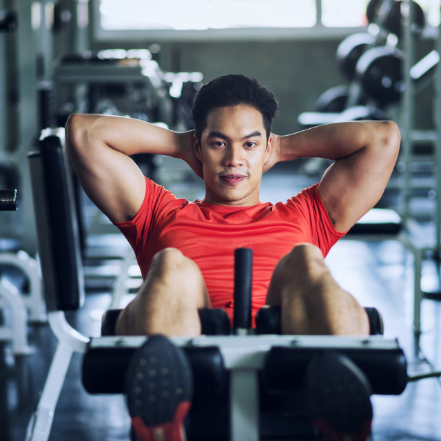 """""""Athletic man sit-up in fitness gym"""" stock image"""