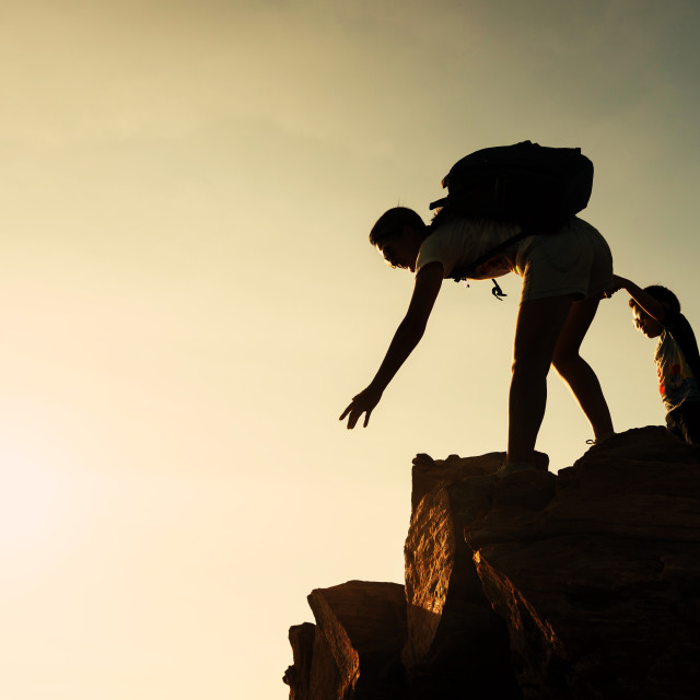 """""""Family hiking to summit at sunset. Help concept"""" stock image"""