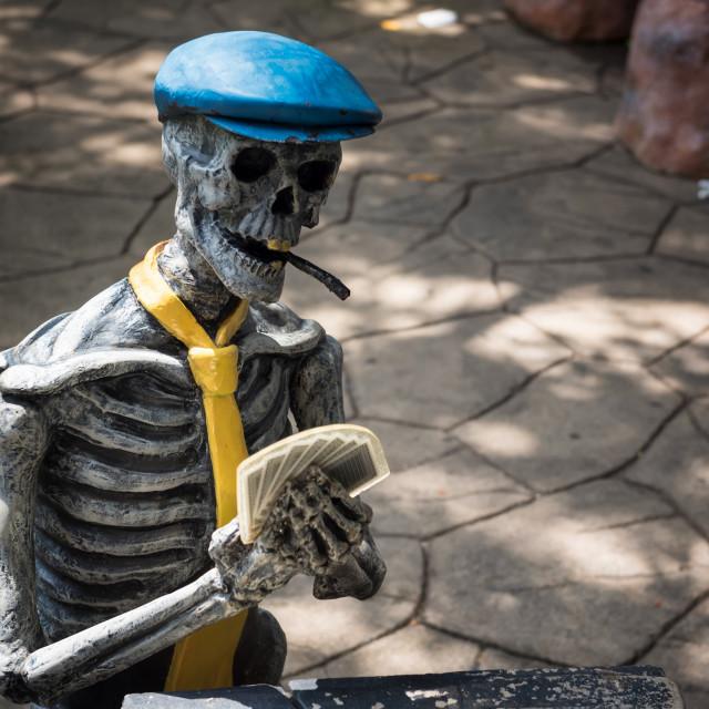 """Skeleton bone ghost play rummy cards."" stock image"