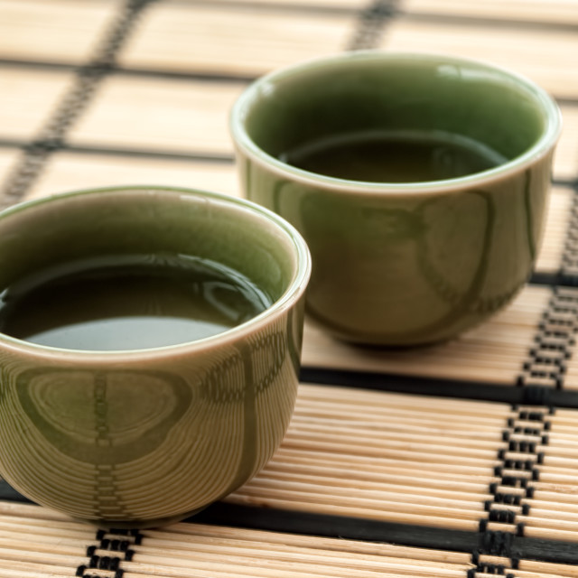 """Chinese Green Tea Cups on Bamboo Mat"" stock image"