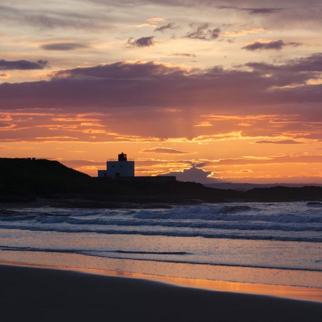 """""""Bamburgh Lighthouse Sunset"""" stock image"""