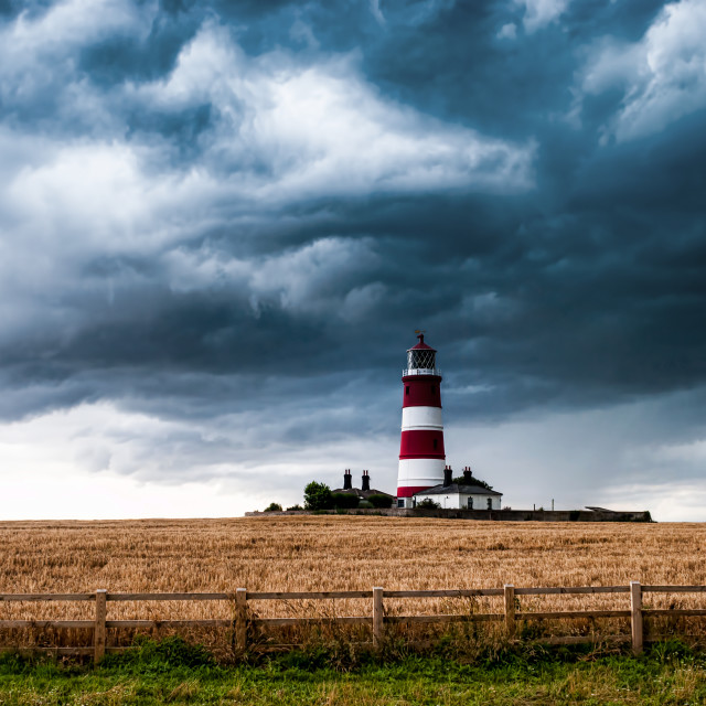 """Happisburgh Lighthouse with stormy clouds"" stock image"